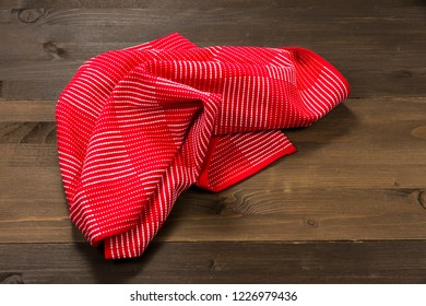 Checkered tablecloth isolated on wooden background