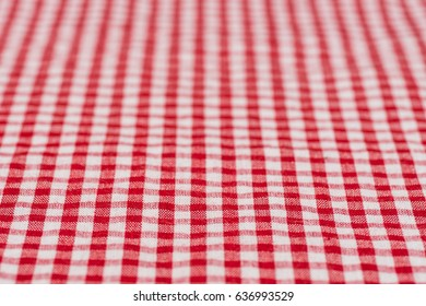 Checkered tablecloth kitchen selective focus. the white and red checkered background. Selective focus.