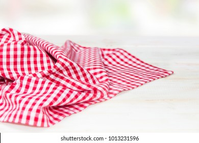 The checkered tablecloth on a table
