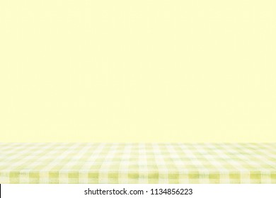 Checkered tablecloth texture top view on yellow background.