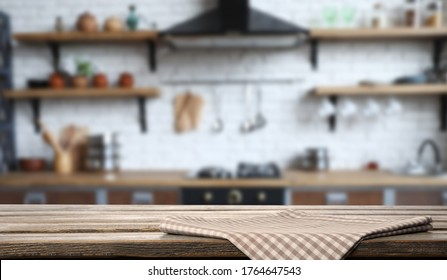 Checkered towel on wooden table in kitchen. Space for text