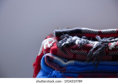 Checkered winter blankets stacked in a pile