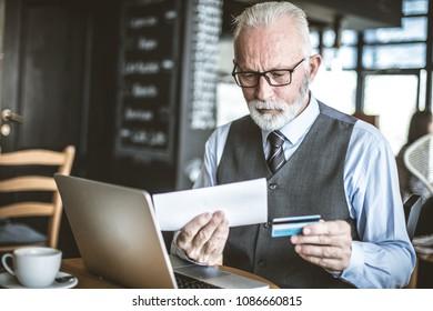 Checking accounts. Senior businessman.