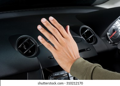 checking the air from air ventilation in the car