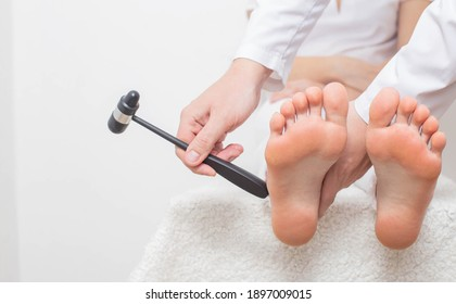 Checking cheddock reflex by a neurologist for the presence of muscle hypertonicity and paralysis diseases, paresis of limbs, copy space, neurological examination