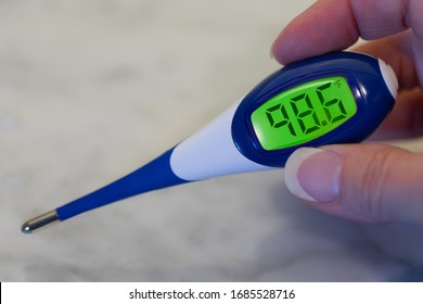 Checking for Fever with Digital Thermometer Showing Normal Temperature in Fahrenheit