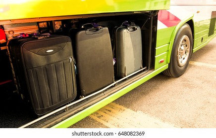 Checking luggage or suitcase compartment on bus. Many heavy luggage load into a bus locker.