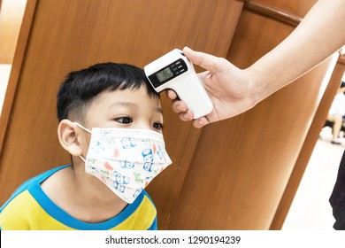 Checking measure fever levels Children using by digital infrared thermometer.