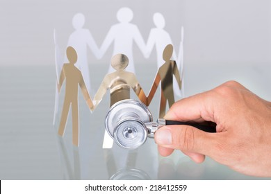 Checking paper cut people using stethoscope in healthcare concept