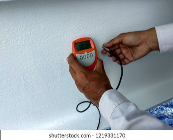 Checking thickness paint by Dry Film Thickness (DFT) for fireproof painting on steel structure.