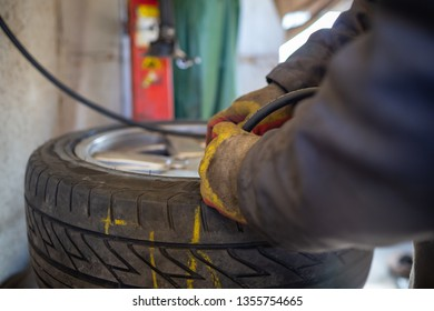 Checking tire pressure. Pumping air into auto wheel. Vehicle safe concept. Car wheel balancing in tire service.