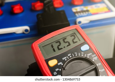 Checking voltage battery of ca with volt meter 12 v. dc
