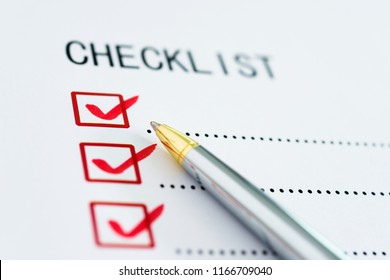 Checklist box on paper with checkmark and pen.