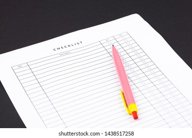 Checklist box with red checkmark, paper and a pen with checklist .