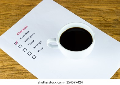 checklist coffee cup on the table.