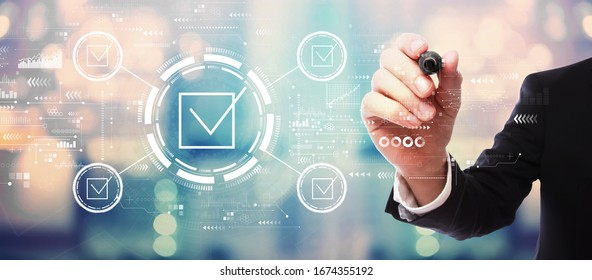 Checklist concept with businessman on blurred abstract background