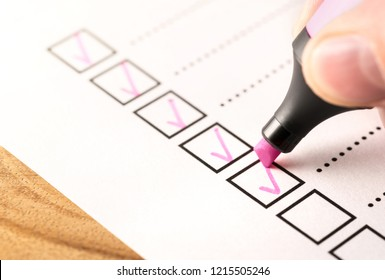 Checklist, keeping score of obligations or completed tasks in project concept. Check list document of finished work duties,  progress or agenda. Business man writing tick mark in checkbox with marker.