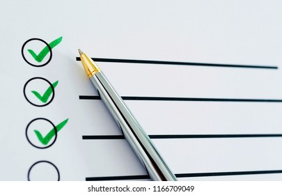 Checklist marked with a pen.