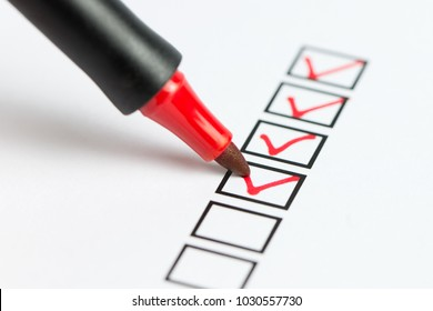 Checklist marked red with a red pen