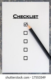 Checklist on blue stone background