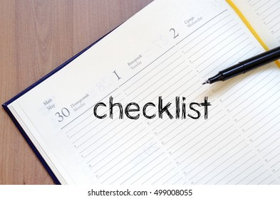Checklist text concept write on notebook