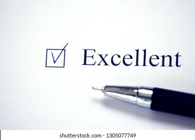 Checklist with a word Exellent on white paper with pen. Checkbox concept.