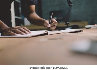 Checklist Writing Notice Remember Planning  assessment Concept,home office desk background,hand holding pen and writing note on wood table.