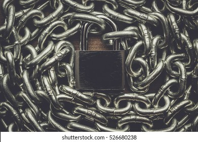 check-lock and chain on wooden background concept