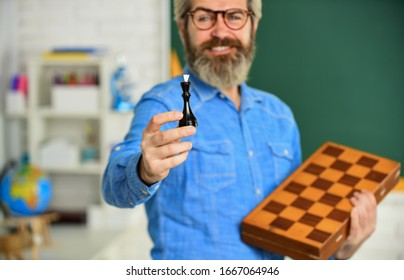 checkmate. Chess in Classroom. game strategy analysis. checkmate. intelligent hobby. selective focus. queen chess piece. leisure school time. Chess club for students. Logic game for brain development.