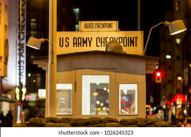 checkpoint charlie berlin germany at night