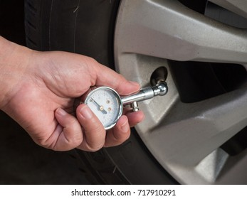 Checks the tire pressure of the car with meter gauge.Concept Travel safety.
