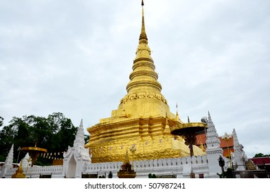 Chedi of Wat Phra That Chae Haeng temple for people visit and pray in raining time at Nan province Northern of Thailand