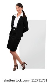 Cheeky woman in a skirt suit