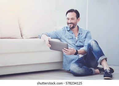 Cheerful adult man resting at home