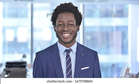 Cheerful African American Businessman Smiling at Camera