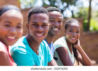 cheerful african american college students on campus
