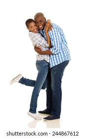 cheerful african american couple hugging on white background