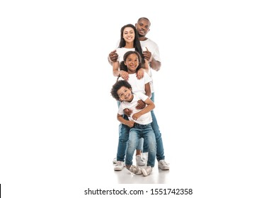 cheerful african american family standing one behind other and smiling at camera on white background