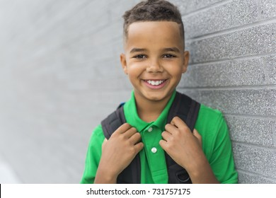 A cheerful african american primary school boy with backpack