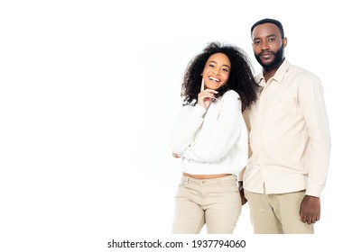 cheerful african american woman standing near smiling husband isolated on white