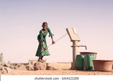 Cheerful African ethnicity Offspring with healthful Water in a village