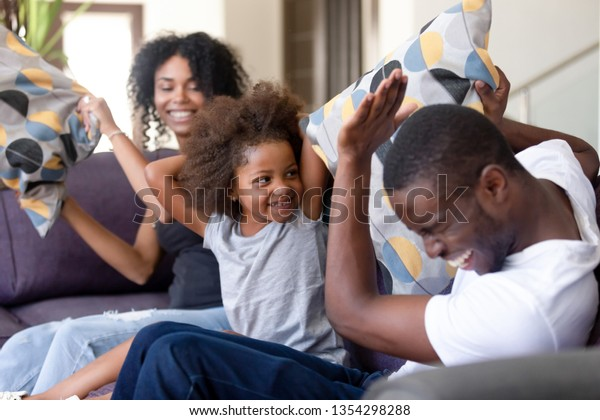 Cheerful African Family Sitting On Sofa Stock Photo Edit Now