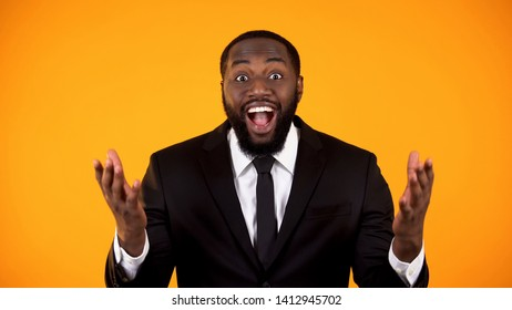 Cheerful afro-american man in businesswear happy with lucrative proposition sale