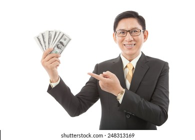 Cheerful Asian businessman pointing at his money