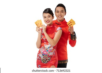 Cheerful Asian couple showing Tet greeting cards