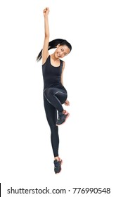 Cheerful Asian woman standing on one leg with hand outstretched. Energetic sportswoman doing aerobics or dancing gymnastics. Full-length portrait of cheerful fit girl isolated on white background