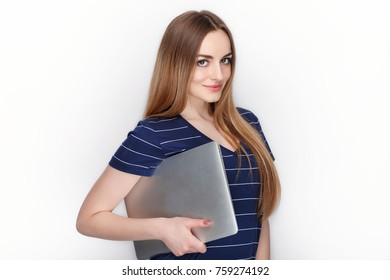 Cheerful attractive caucasian blonde woman with using slim elegant notebook computer isolated on a white background