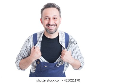 Cheerful attractive mechanic with metallic spanner acting like superman and tearing his shirt off isolated on white background