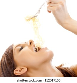 Cheerful attractive woman eating spaghetti, isolated over white background