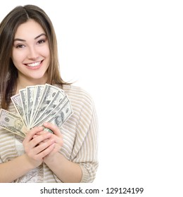 Cheerful attractive young smiling woman holding cash, over white